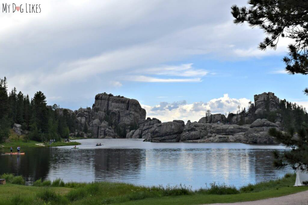 The picturesque Sylvan Lake at Custer State Park surrounded by large granite peaks and spires.