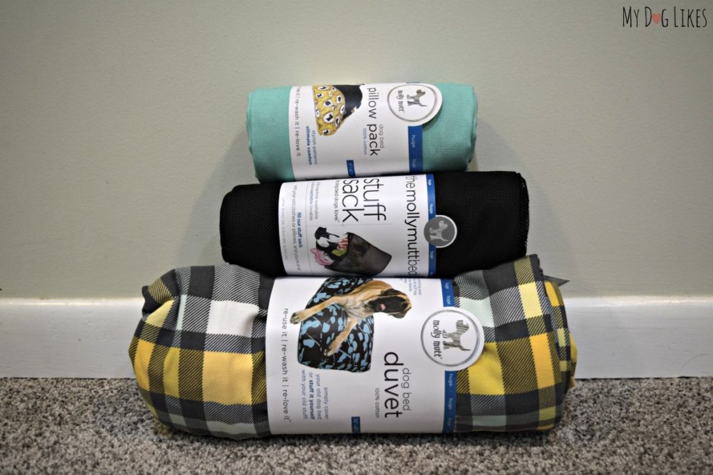 The components of our Molly Mutt Dog Bed - 1 duvet, 1 stuff sack, and 1 pillow pack