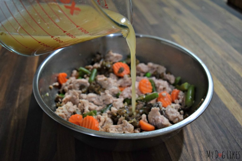 Adding a low sodium broth to dog food is a great way to encourage them to eat.