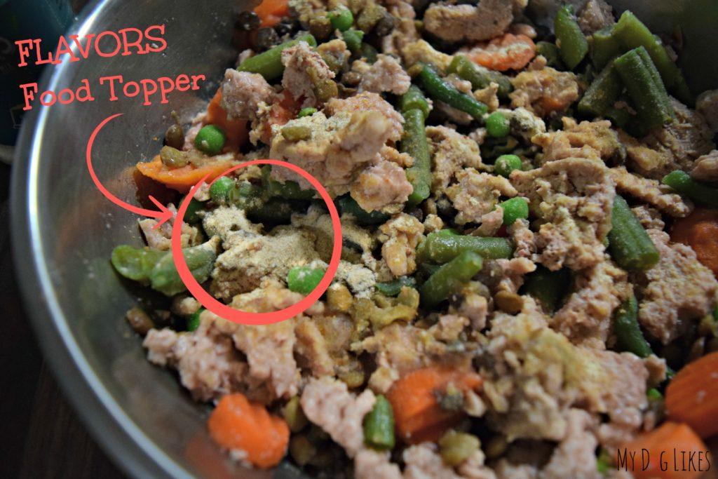 Food topper sprinkled on dog food