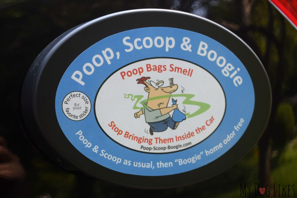 The Poop, Scoop and Boogie is a travel trash can that attaches to the exterior of your car