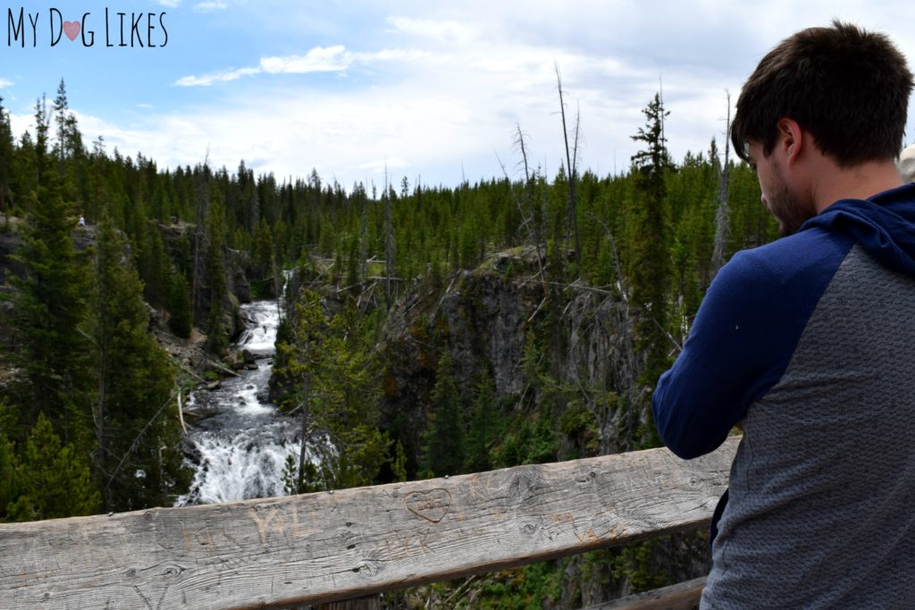 Taking in one of the hundreds of waterfalls in Yellowstone National Park