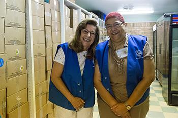 Two Smiling Volunteers at a Food Pantry