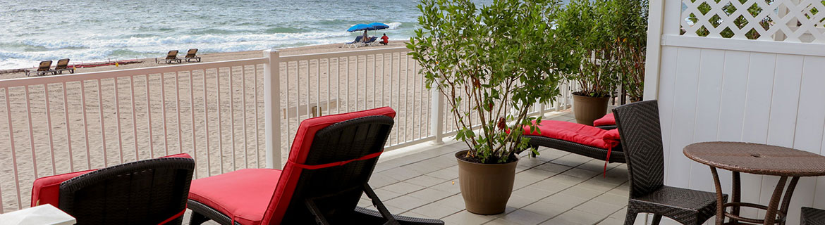 Sun Tower Balcony with Red lounge chairs ready for the snowbirds