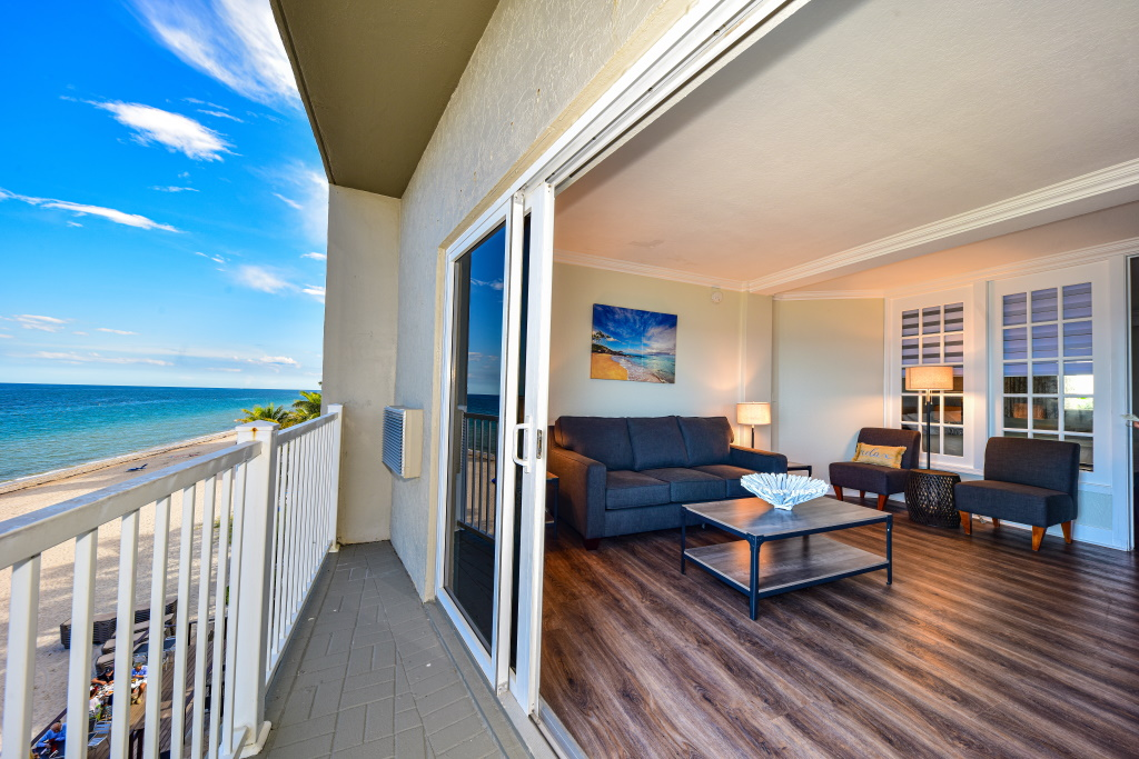 View from the deck into the Oceanfront Standard Suite with King Bed