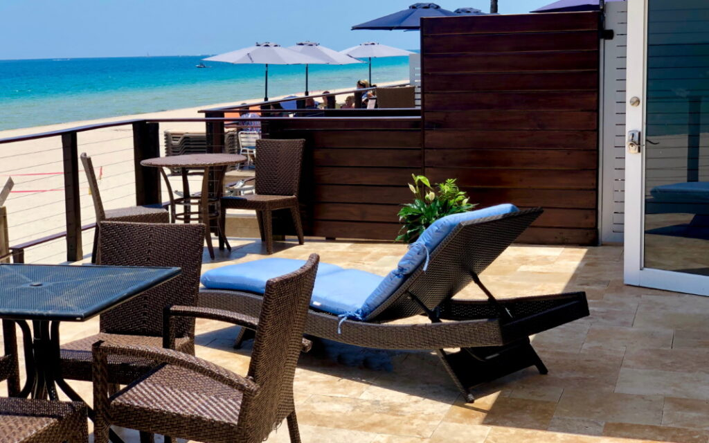 Lounge chairs on deck with ocean