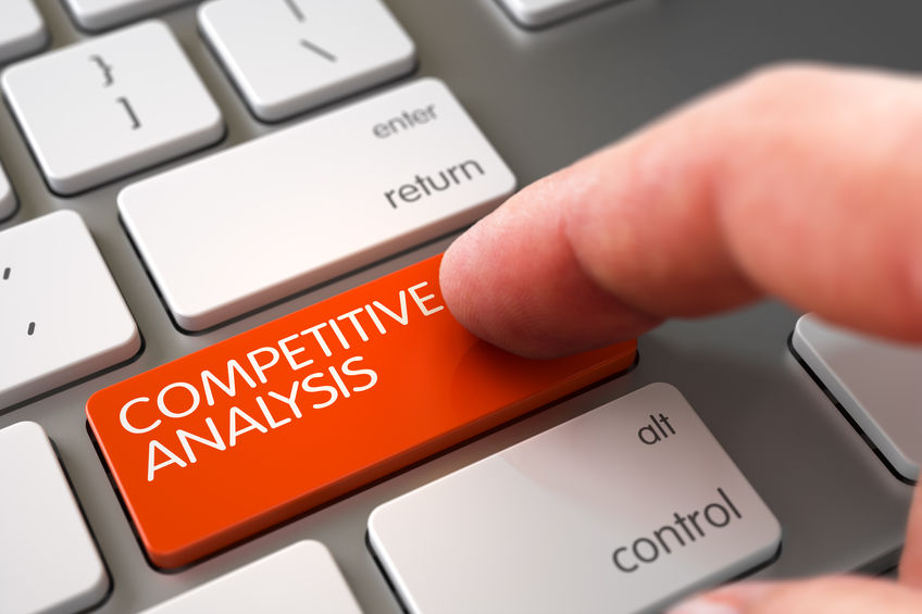 image of computer with key for competitive analysis