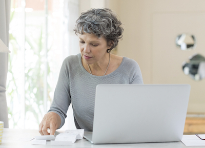 Woman using live chat to talk to a health care customer service agent