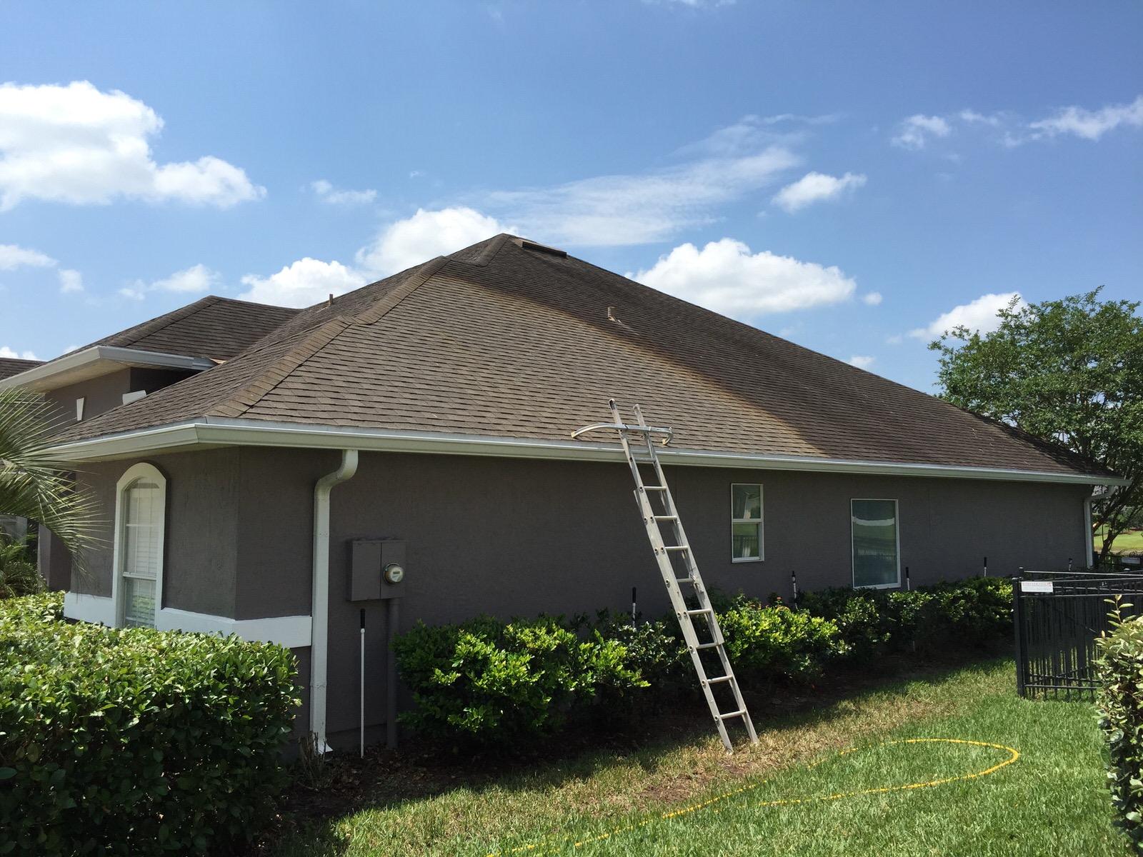 Asphalt Shingle Roof Cleaning In Progress
