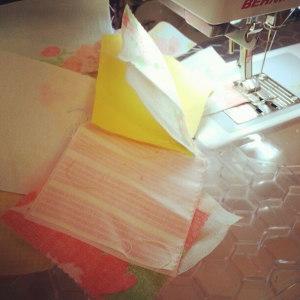 postage stamp quilt progress