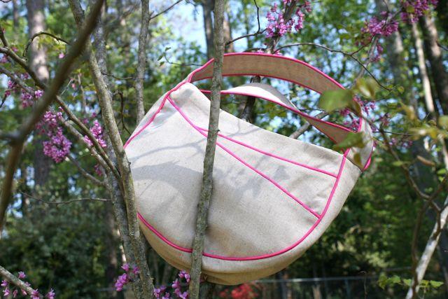 asymmetrical pockets handbag | whipstitch