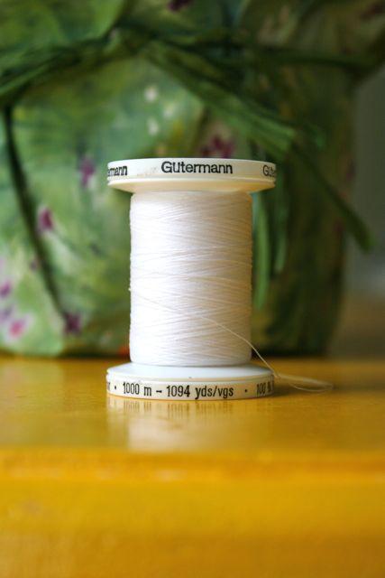 white thread spool