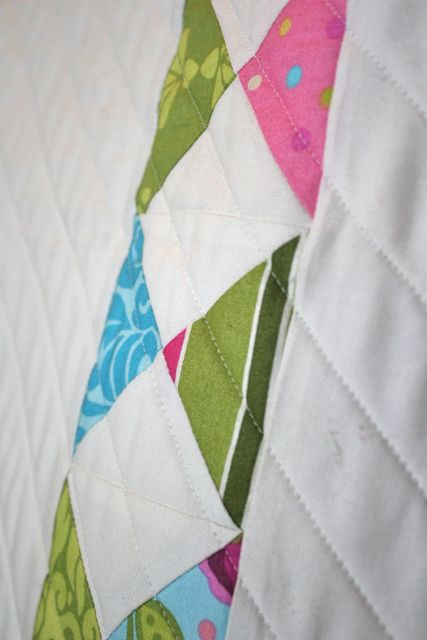 half square triangles with straight line quilting