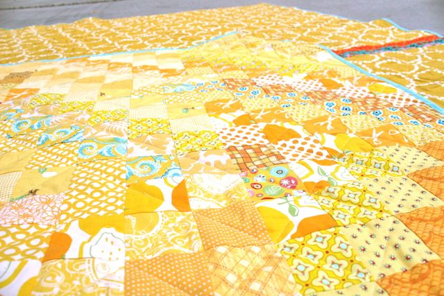 all-yellow scrappy postage stamp quilt