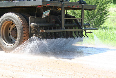 Quality Propane provides affordable dust control for gravel roads.