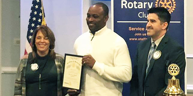 A picture showing Cyril Hart being inducted into the Rotary Club.
