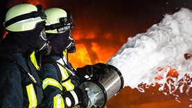 fire fighters using chemicals