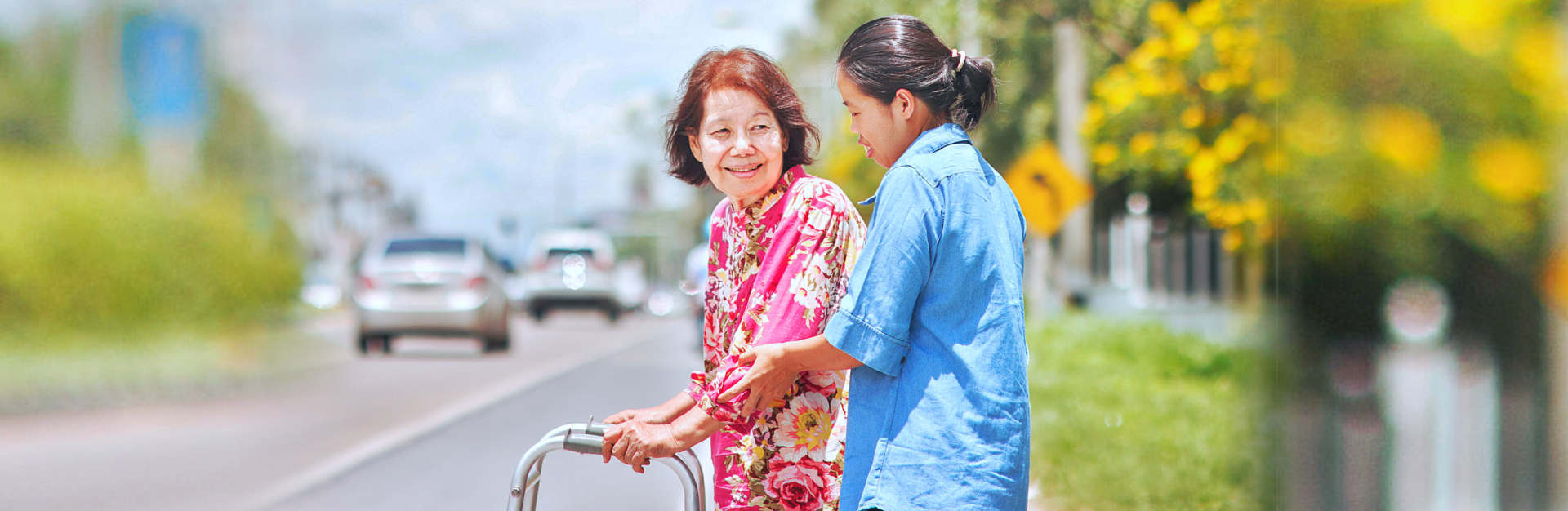 caregiver assisting senior woman in crossing the street