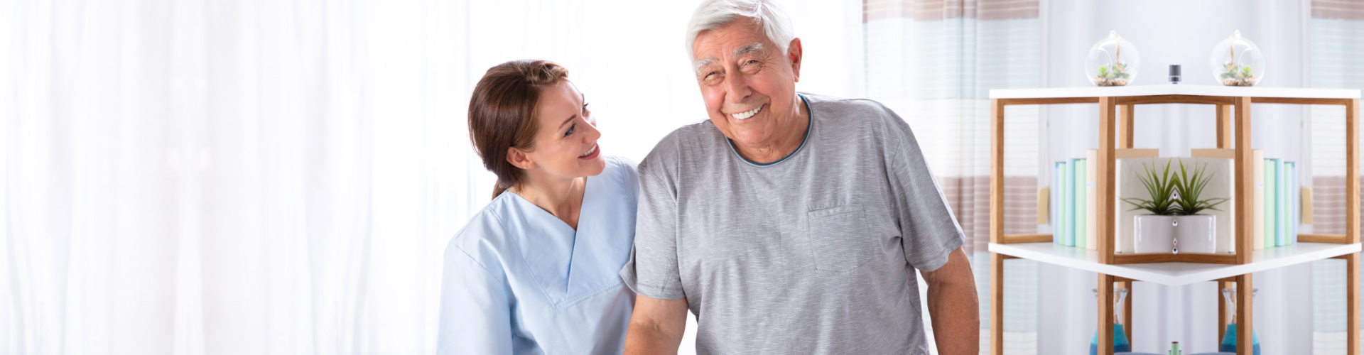 healthcare professional assisting senior man