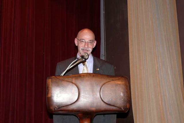 John Humphrey speaking at a conference podium