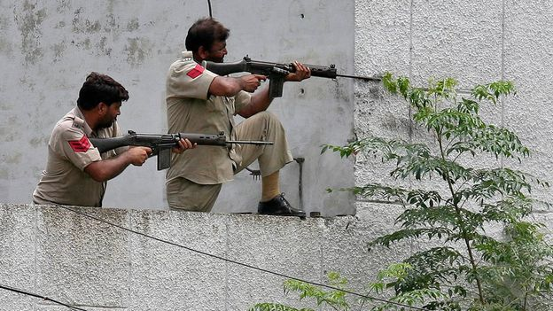 Indian police firing on attackers