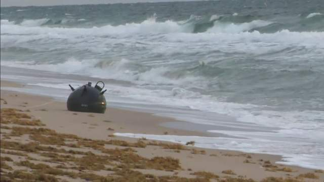 A possible military explosive device washed ashore on a Florida beach-wittyculture