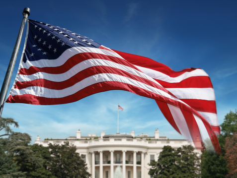 American Flag in front of The White House in Washington D.C. Background out of focus. Photomontage. SEE MY OTHER PHOTOS & VIDEOS from USA: