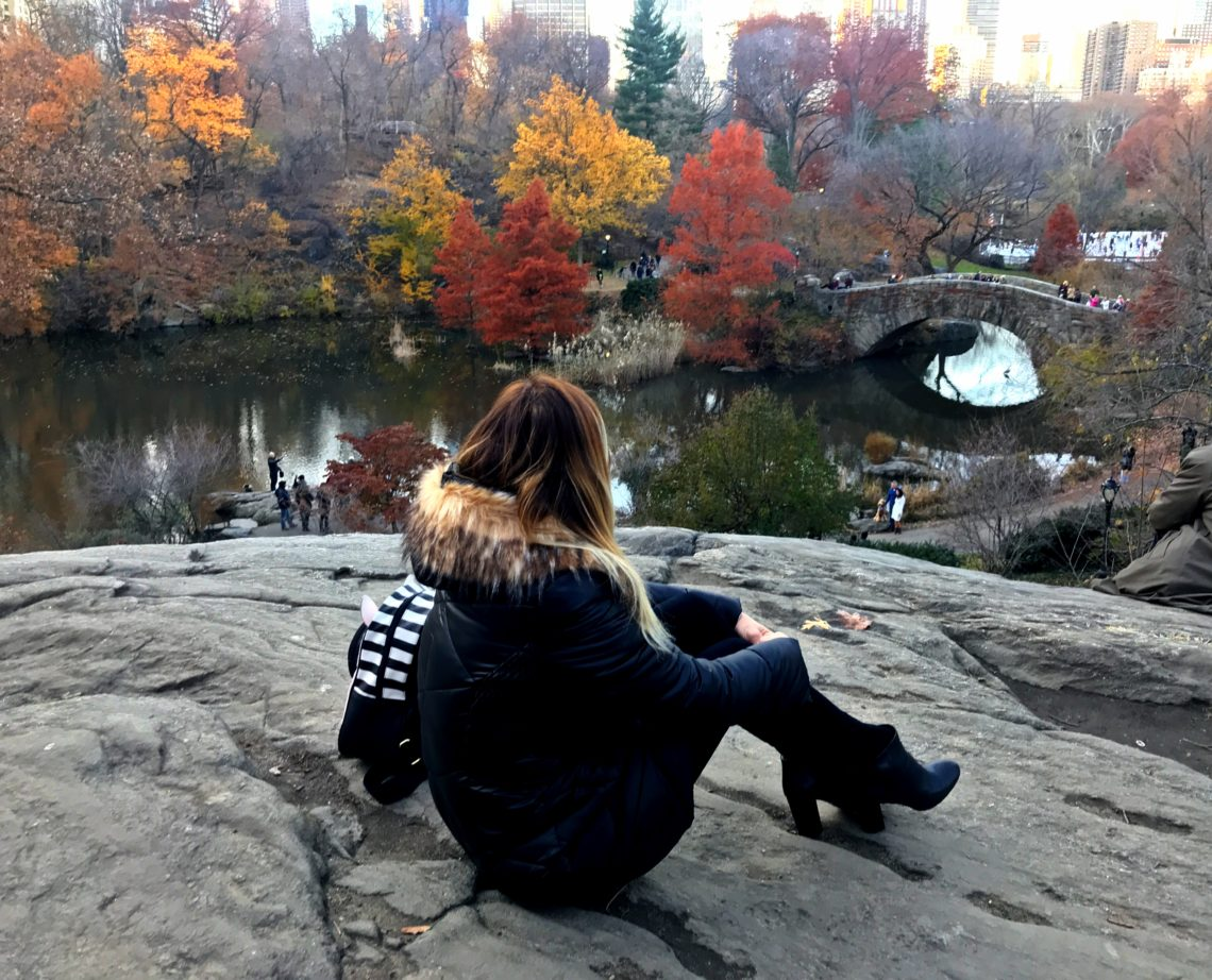 Woman in central park during FAll