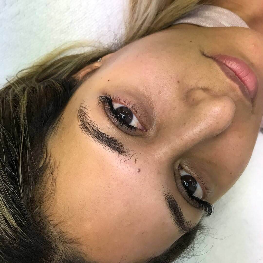 Eyewonderlust Difference Between Good and Bad Set of Eyelash Extensions Blog - Female Closeup with Long Bowed Black Eyelashes