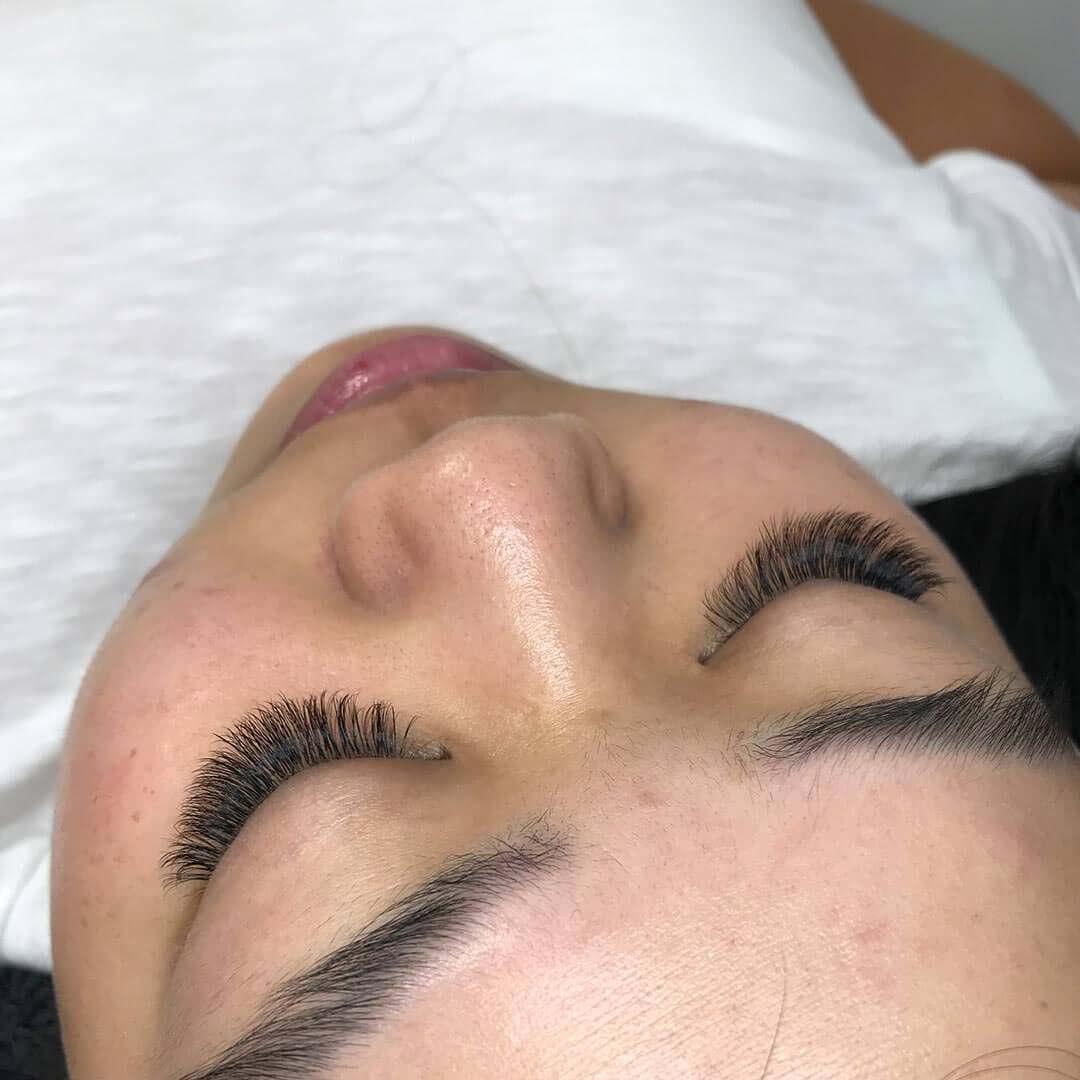 Eyewonderlust Eyelash Extensions Cannot Damage Lashes Blog - Woman with Long Dark Wavy Lashes