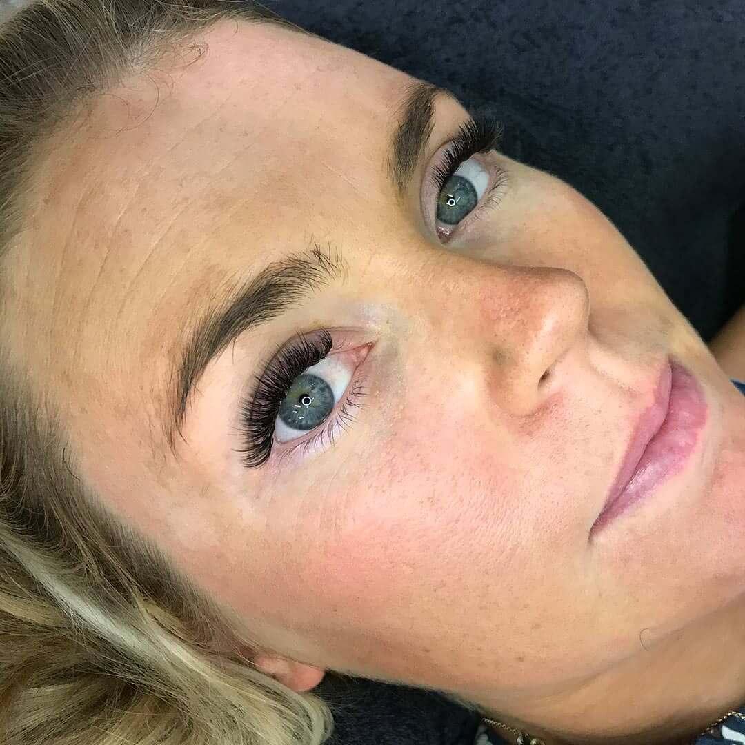 Eyewonderlust Understanding Your Eyelash Extensions Blog - Female Closeup with Long Bowed Black Eyelashes