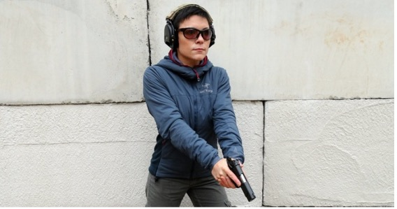 Pistol shooter in low ready position