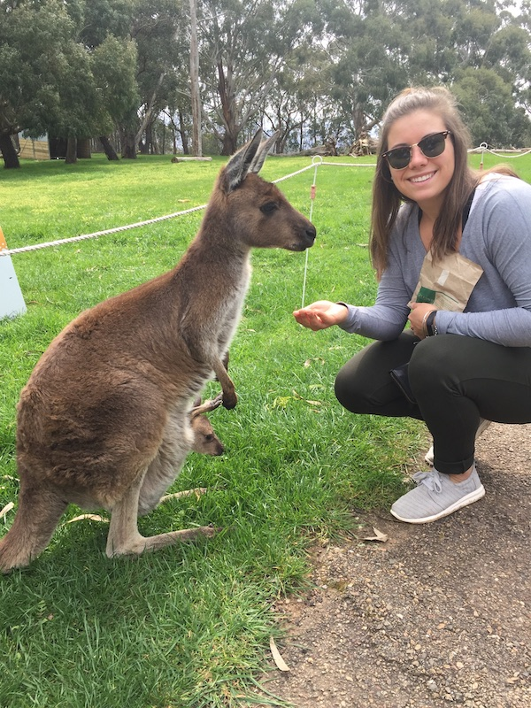 Fitness instructor Ashley Pelkey poses with a kangaroo