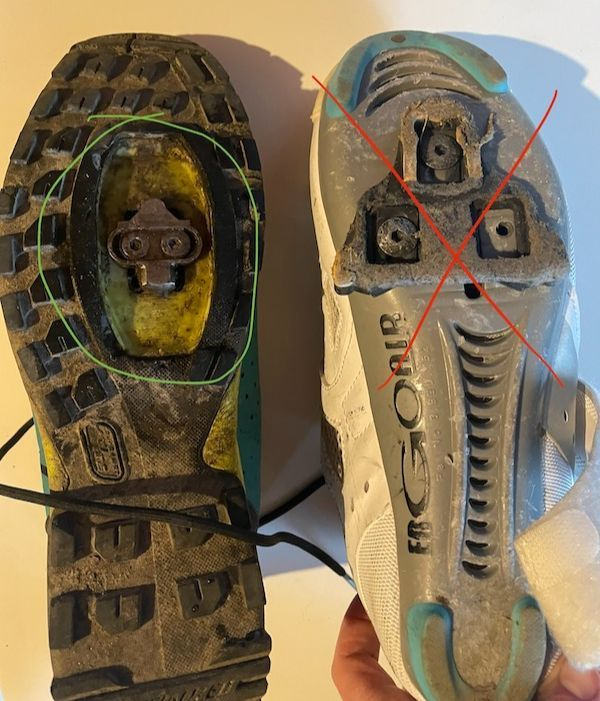 two bike shoes side by side, showing the bottom of the shoes. One has the correct cleat and one has the incorrect cleat