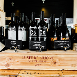 Black bottles of wine on display on Wise Ox shelf