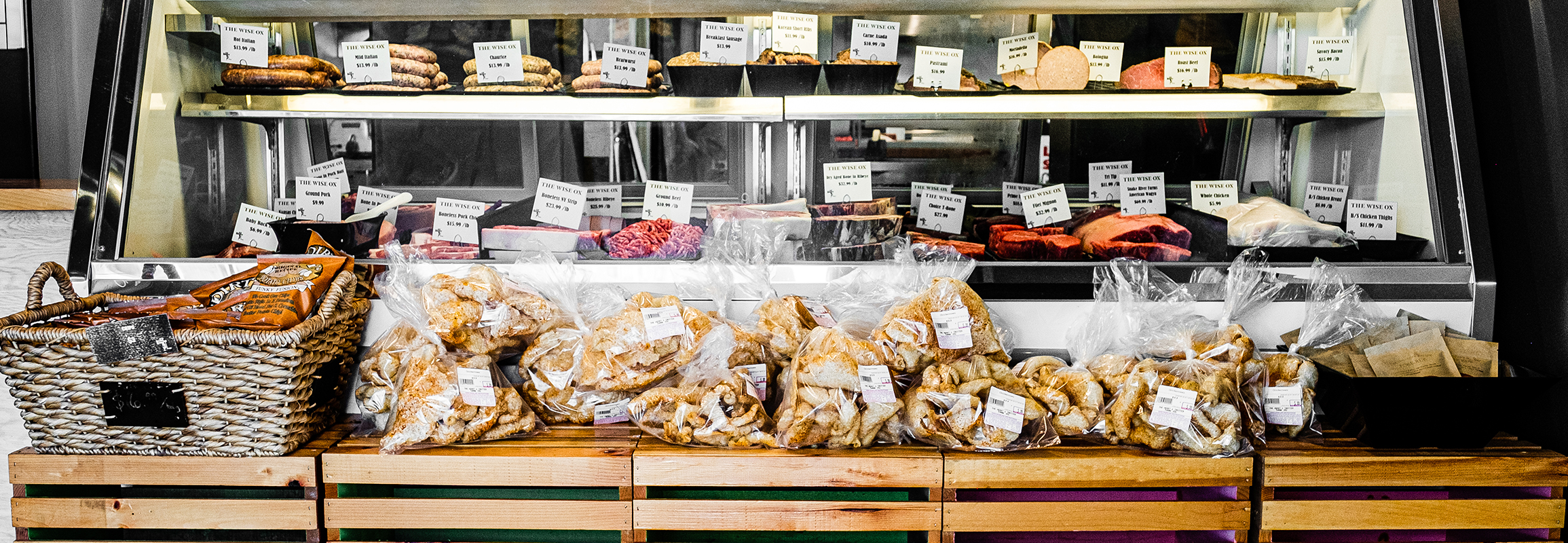 Deli case at the Wise Ox displaying various meats