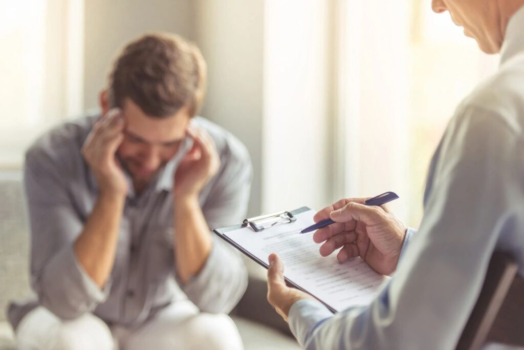 Man in distress receiving counseling