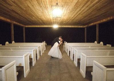 Bride and Groom Kissing Under The Oakmont Pavilion