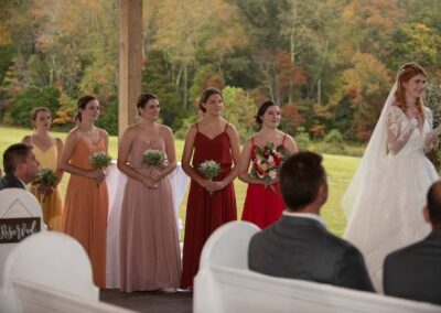 The Fall colors glowing behind the brides maids