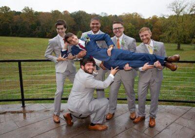 The groomsmen overlooking the greenway