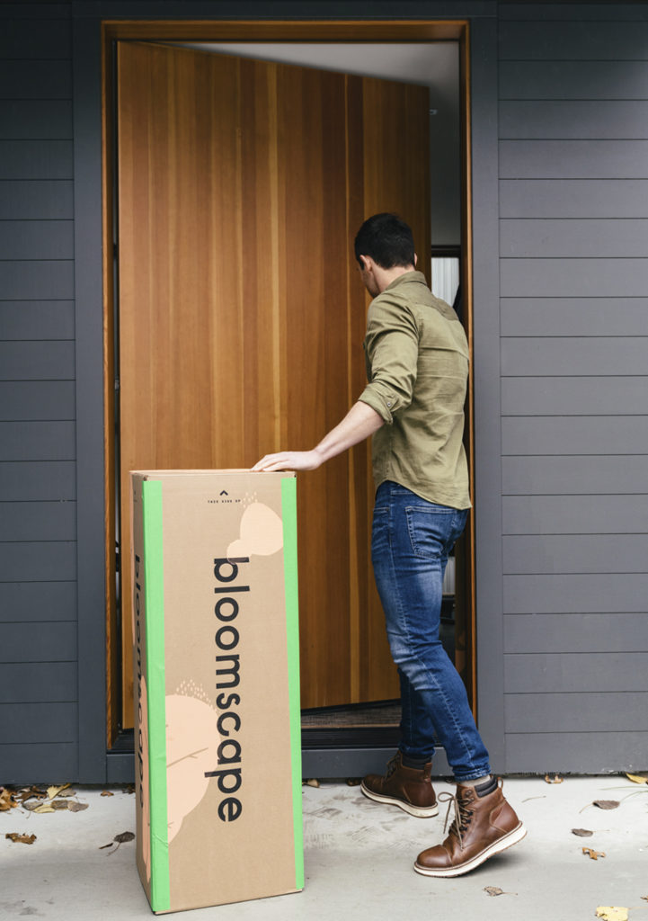 man with bloomscape box