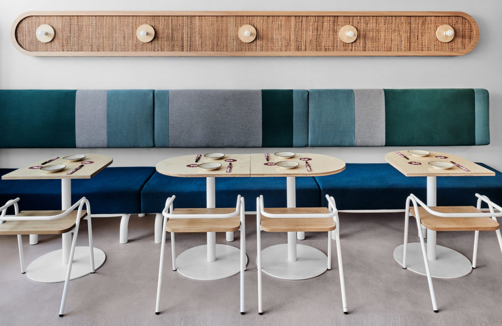 Banquette with tables and chairs in a restaurant