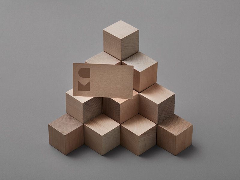 Carpenter and Mason business card on wooden blocks