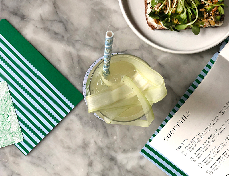 A cocktail and menus at Sunday in Brooklyn