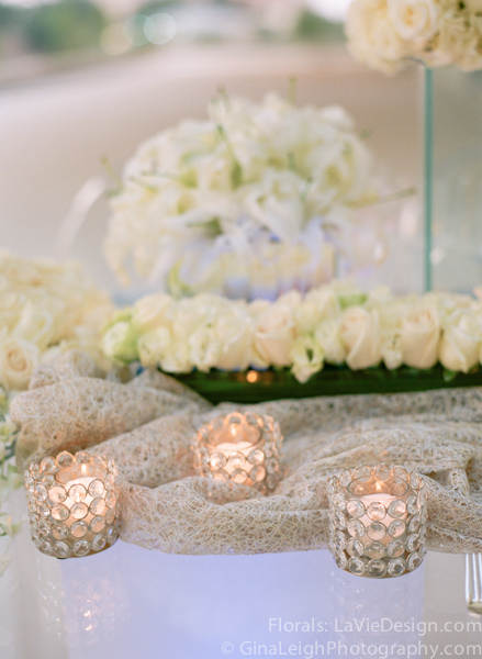 la-vie-en-rose-tampa-bay-wedding-magazine-summer-2011-white-ivory-candle-burlap-votvies-glass-shell-charger-silver-cover-shoot-musume-of-art-florida