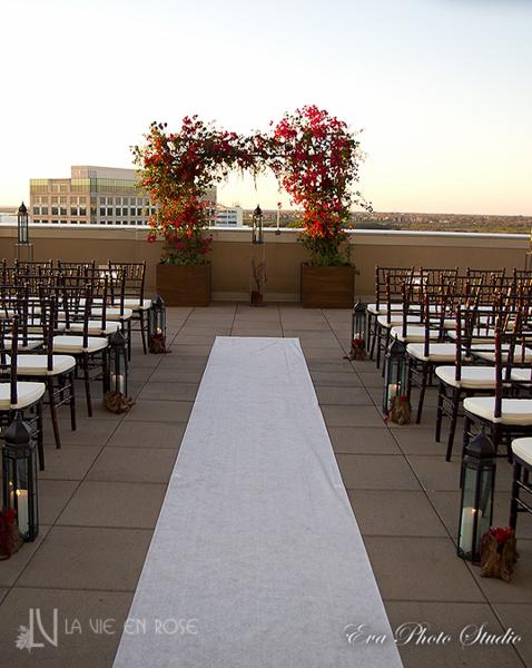 la-vie-en-rose-wedding-ceremony-strucutre-white-runner-bougainvilliea-grapes-orchid-amaranthus-berries-lanterns-candles-westin-tampa-bay-florida