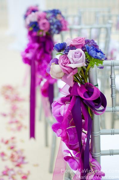 la-vie-en-rose-pew-decorations-purple-ceremony-hyatt-clearwater-beach-florida