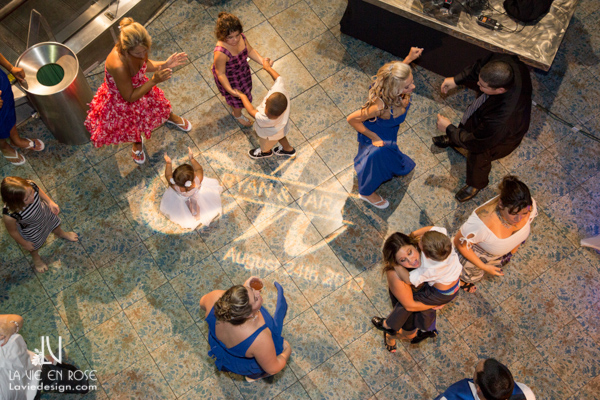 la-vie-en-rose-wedding-reception-dance-floor-pin-light-monogram-table-florida-aquarium-tampa