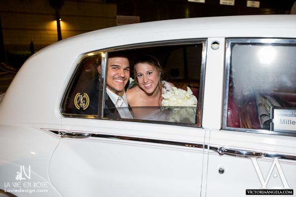 la-vie-en-rose-wedding-exit-white-rolls-royce-florida-aquarium-tampa