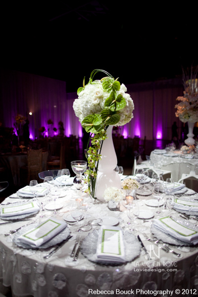 la-vie-en-rose-special-event-jouney-to-love-white-guest-table-modern-centerpiece-ranunculus-hydrangea-green-cymbidium-orchid-anthurium-reception-purple-up-light-tampa-florida